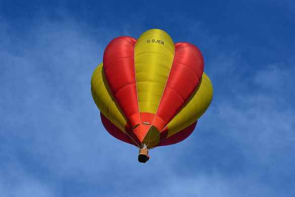 yellow and red hot air balloon in sky